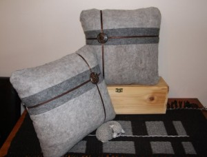 Here is a pair of grey felt cushions with fabric on the back & contrasting brown buttons and ribbon